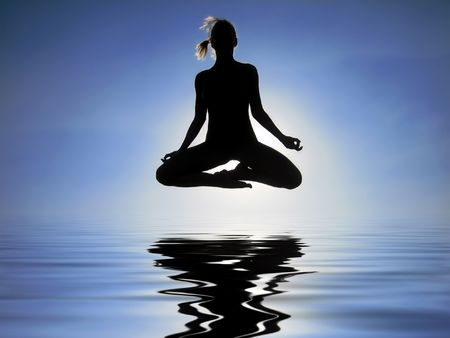 Female yogi flying over the water