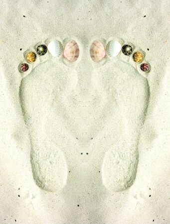 Human footprints on the sand decorated with shells