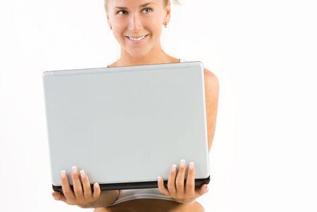 positiveness: Rubia feliz ni�a peque�a computadora en sus manos Foto de archivo