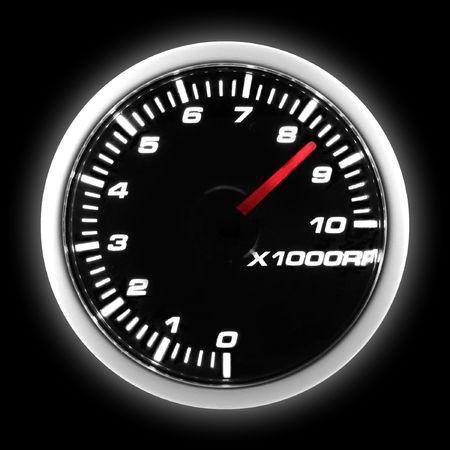 gauge: Car tachometer at maximum level on black background
