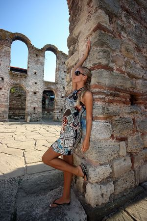 bulgaria girl: Beautiful blonde girl in sunglasses at the column in old town Stock Photo