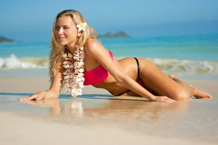 Blonde girl with tropical flowers on Hawaii sand beach Stock Photo - 6309122