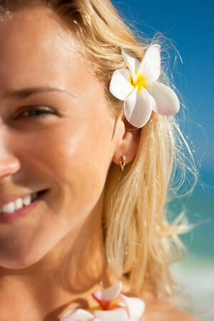 Portrait of a girl with tropical flowers in hair Stock Photo