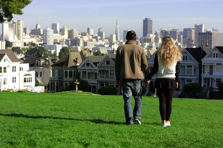 Young couple walking along the park in San Francisco Stock Photo