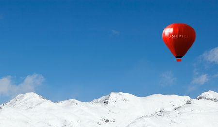 America sports competition air balloon over the mountains Stock Photo