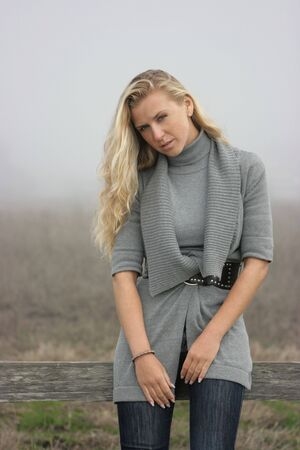Blonde model girl with long hair on the farm photo