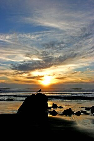 Beautiful sunset over the rocky beach on Big Sur Stock Photo