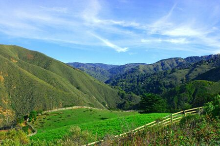 Typical California landscape with green grass and ranch