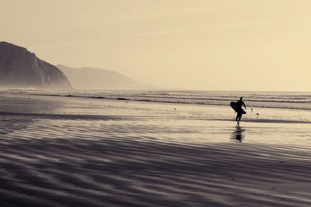 Surfer silhouette on the California beach photo