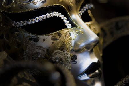 Part of venetian mask on black background Stock Photo