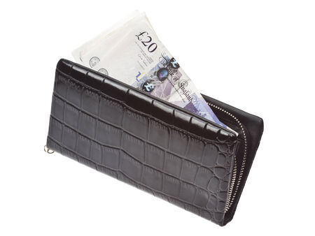 Black wallet with money isolated on white background. photo