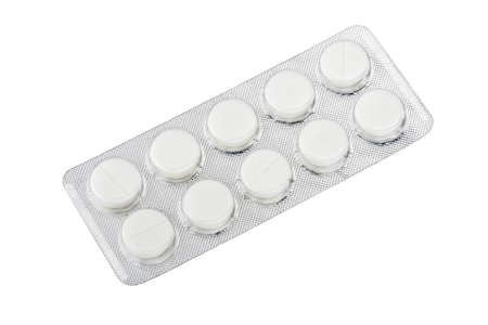 Medical pills in silver blister packs isolated on white background 스톡 콘텐츠