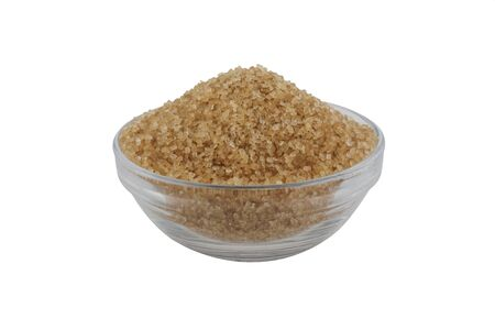 Brown sugar in glass bowl isolated on white background