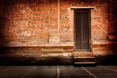 Red brick walls and old wooden doors  Standard-Bild