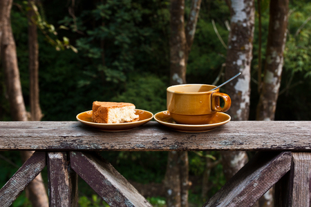 Coffee and cake balcony fence,The background is a forest photo
