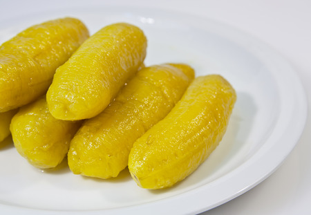 Banana in syrup , very sweet dessert in Thailand photo