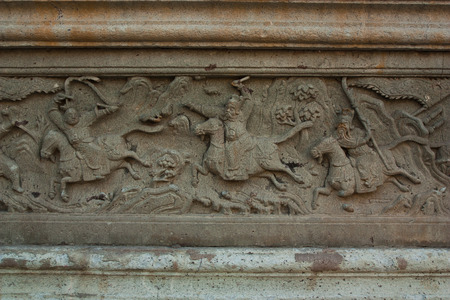 Rock Carvings on temple wall Thailand  photo