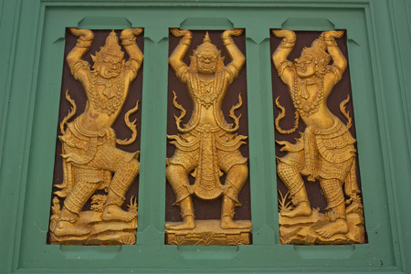 Wood carving is a giant figure in Thai Temple  photo