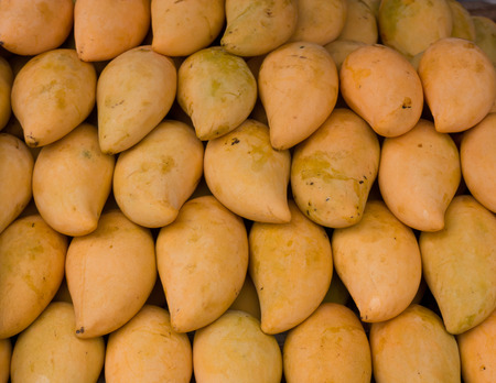 Ripe mangoes sold in the bazaar photo