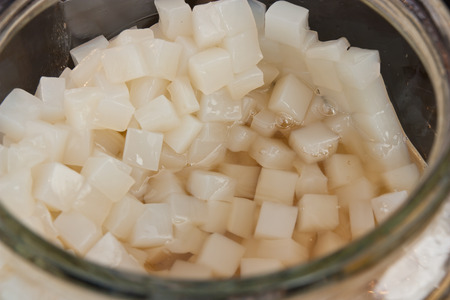 Coconut jelly in glass pots and in desserts