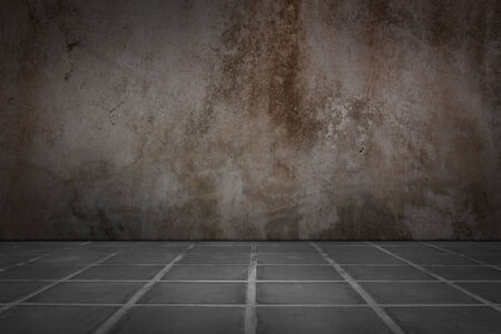 rustic background: Old concrete wall and floor tiles.