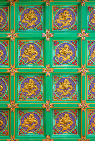 Texture Background of Gold Carved Wood Dragon in Chinese Temple in Bangkok, Thailand. photo