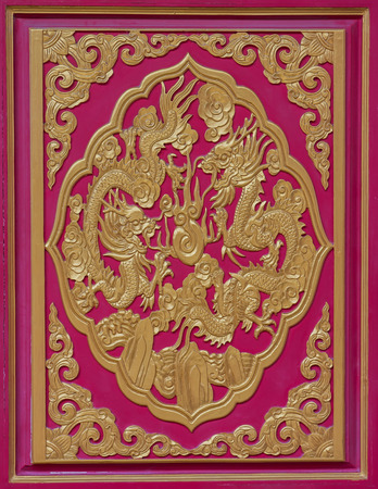 Wood carved dragon on the wall of the temple, Thailand. photo