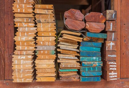 flute structure: Pile of wood stored in stock on shelf,Wood thailand market.
