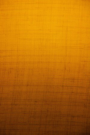 suface: Light yellow light shines through the fabric to see the details of the surface of the fabric. Stock Photo