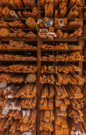 flute structure: Pile of wood stored in stock on shelfWood thailand market. Stock Photo