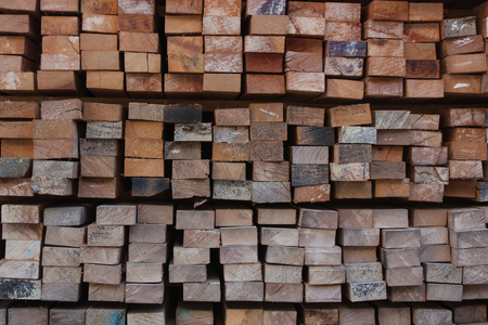 flute structure: Pile of wood stored in stock,Wood thailand market. Stock Photo