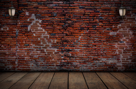 wooden floors: The lamp on the red brick walls and old wooden floors, Abstarct background.