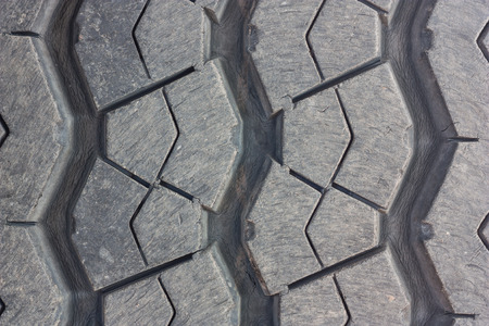 tire tread: Close-up, tire tread wear of the surface through the use of a car.