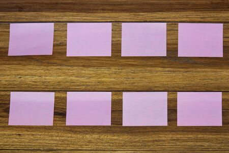 postit: Post-it notes on wooden background. Stock Photo