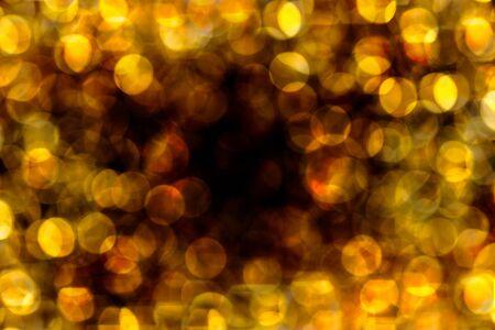 Bokeh 밤 빛, 추상 미술 배경 흐리게의 노란색 배경.
