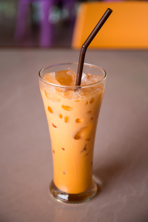 Iced milk tea or Thai milk tea on the table.