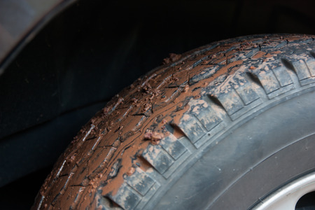 Mud stick on the tire front of the car.