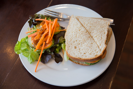Sandwiches and salads on a white plate, breakfast. 스톡 콘텐츠 - 111068301