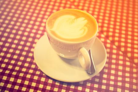 Latte art in the restaurant, vintage style lighting.