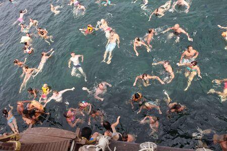 warm water fish: People enjoy swimming in the Aegean Sea Editorial