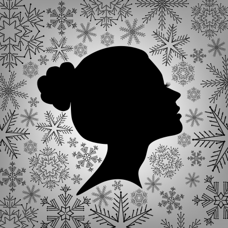Silhouette of a female head against from snowflakes