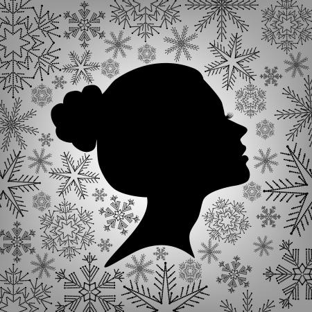Silhouet van een vrouwelijke hoofd tegen van sneeuwvlokken