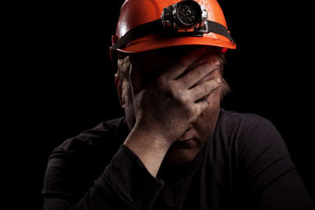 the miner: Coal miner on a black background Stock Photo
