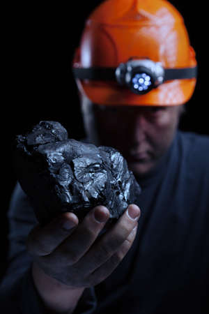 Coal miner on a black background Stock Photo - 18872167