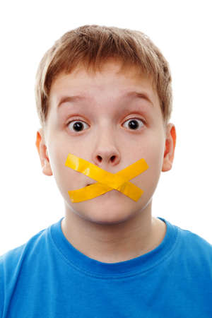 silenced: Sad  boy with silenced with tape.  Stock Photo