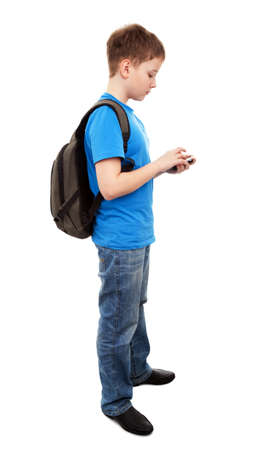 Schoolboy sending message from phone mobile isolated on white background  photo