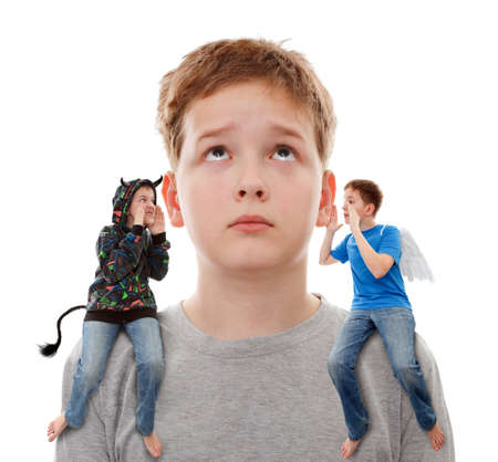 Teenage boy in contradiction, on one shoulder  sits an angel, and on other sits devil Stock Photo