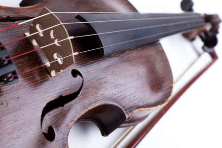 cellos: Old violin on white background Stock Photo
