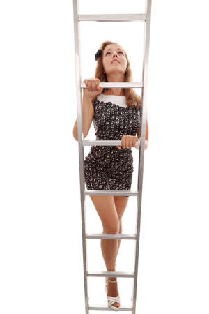 The young beautiful girl goes upward on a ladder on a white background