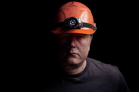 COAL MINER: Coal miner on a black background Stock Photo